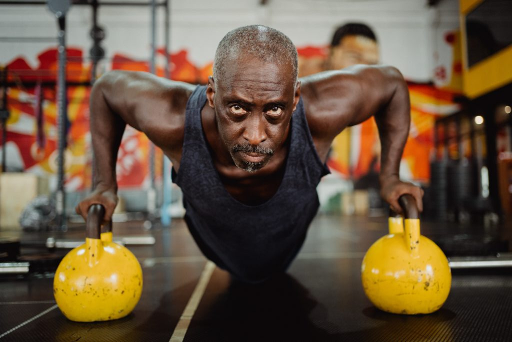 Man at the gym exercising. Natural way to boost energy